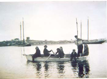 Left to Right: Jesse,Cyril,Blanche,& Evelyn Janes; Roland Rogers, Ron Janes and Effie Janes. 1940Schooners Athlete and Maggie Blackwood in the background.